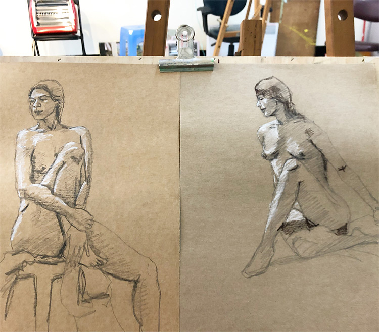 Figure drawing sketches on toned paper