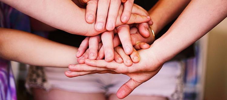 Hands posed together