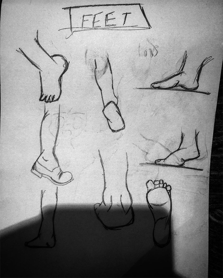 Dark pencil drawings of feet