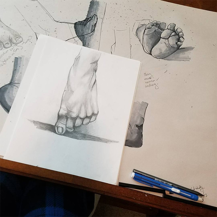Detailed foot drawn in realist style