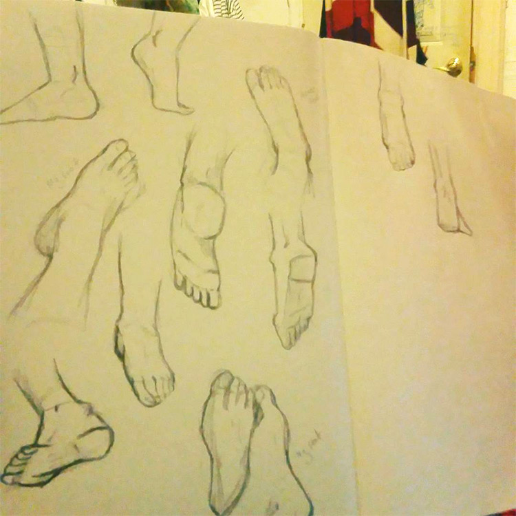 Quick sketches of feet inside practice sketchbook